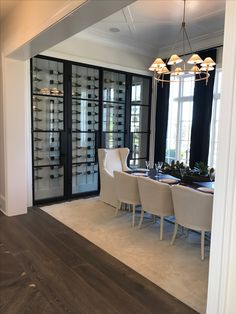 These bottles are too far apart and I would not like the white backing but what about a stone backing with black on the outside to match the windows? I like the idea of placing the unit above so that you can reach the bottles? Glass Wine Cellar, Home Wine Cellars, Wine Cellar Modern, Modern Wine Rack, Wine Rack Design, Wine Cellar Design, Wine Rack Wall, Wine Racks, Wine Wall Decor