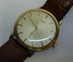 A gentleman's 9ct gold cased Longines wristwatch on associated leather strap
