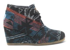 A warm winter wedge is a necessity for colder climates, pair this one with faded jeans or tights! // TOMS Black Jacquard Desert Wedge