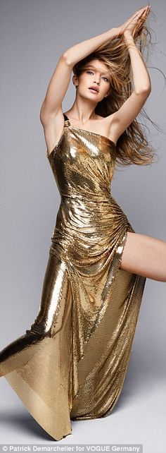 Style tips: Gigi was wearing the stunning gold dress worn by Naomi Campbell in the Versace...
