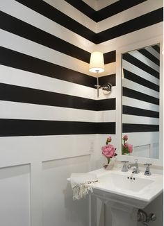 Perfect for a powder room or other small bathroom. Horizontal stripes make a space look larger by tricking the eye into thinking the space is wider.