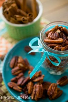 Looking for an easy nibble to set out at your next party or to give as a sweet hostess gift? Check out these easy to make pumpkin pie spiced pecans.