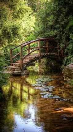 Isamu Taniguchi Japanese Garden's Togetsu kyo bridge at Zilker Botanical Gardens in Austin Texas, United States of America.