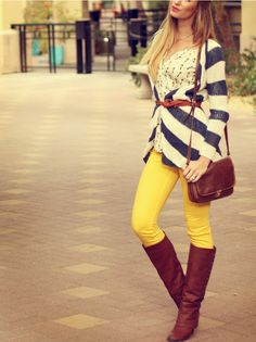 love the blue and white stripes over the printed shirt, those great yellow skinnies, and those amazing boots with matching shoulder bag.
