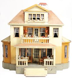 Ladenburger Spielzeugauktion GmbH. I don't know what this means? But the dollhouse is well designed, like detail and soft colors. ......Rick Maccione-Dollhouse Builder www.dollhousemansions.com