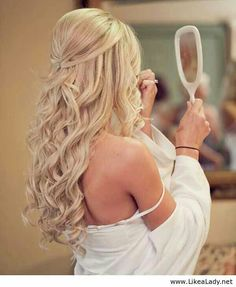 Beautiful wedding half up hair style for long or medium length hair.