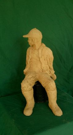 Patrick sitting front view clay sculpture