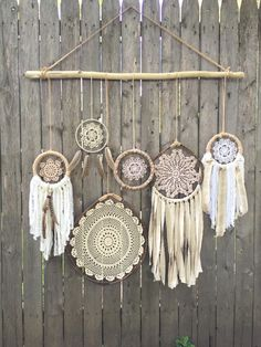Daydreamer' Boho Chic Driftwood + Doily Dreamcatchers Wall Hanging by FoundandFeathers on Etsy https://www.etsy.com/listing/221347419/daydreamer-boho-chic-driftwood-doily