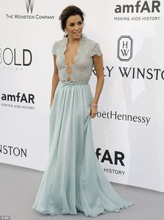 Ready to pose: Eva made a sweeping entrance to the party in her mint-coloured dress...
