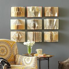 Book Wall Art - Cut a piece of backing board into a rectangle 1 to 2 inches smaller than the back of your opened book; hot-glue to book. Now it's time to get creative! Have fun folding your book pages in whatever way you like best; we recommend dividing the book into even sections for a symmetrical look. We hung nine books in rows of three by securing them with brads hammered into the corners of each book.