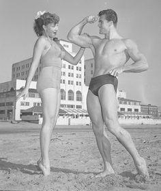 Ed Holovchik [aka Ed Fury], bodybuilder and Mr. Los Angeles contestant with model Jackie Coey, 1953