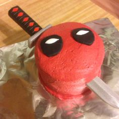 Deadpool cake for my brother-in-law; cut up a Nerf sword to fit the size of the cake.