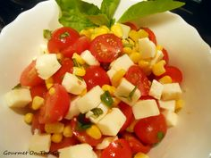 Corn Caprese Salad  1 c. fresh or frozen corn   2 c. grape or cherry tomatoes, halved  1 c. fresh mozzarella, chopped    2 Tbsp fresh basil, chopped  2 Tbsp white wine vinegar  1 Tbsp olive oil  pinch of sugar (optional)  salt and pepper to taste  Blanch the corn in boiling water for 3 minutes drain and cool.  Combine tomatoes, mozzarella, basil, and corn in a large mixing bowl.  In a separate bowl, whisk vinegar, olive oil, sugar then toss with the corn mixture.    201 calories per cup