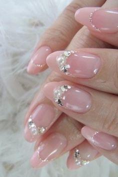 Nude coloured embellished nails