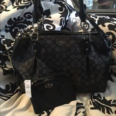 Coach handbag & wristlet Bought this bag last summer. 3 main compartments, pockets on the inside of the middle compartment. Lots of storage. No stains. One of the supper pockets has a hole at the bottom. Still has care card inside. I have the wristlet as its own listing in my closet so details on it are on there. Coach Bags