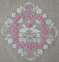 Sweet Bunny Love Cross Stitch Pattern ~ Instant PDF Download ~ A pretty springtime composition of snow white bunnies and pink hearts. It's stitched with beautiful silk on raw linen. It can be worked with either all white or a mix of white and pink thread ~ Pretty cross stitch!