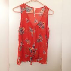 Orange floral blouse Orange floral blouse is sheer with button down closure and ties in a knot at the bottom. Tops Blouses