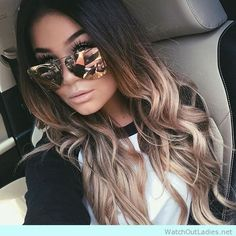 Brown to blonde ombre with loose waves and hologram sunglasses