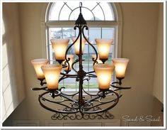 """9 light chandelier, includes photo of view from bottom, Height: 35.25"""" Width: 34"""", $1150 (ouch), avail as 6 light too,  http://www.lightingdirect.com/golden-lighting-4002-9-loretto-9-light-chandelier/p880525?intcmp=recs~item_page.rr1~ClickCP~Golden%20Lighting~goldenlighting40029"""