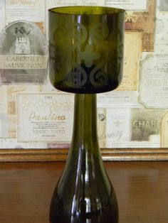 Repurposed Wine Bottle Vase / Candle Holder with Frosted Design. $20.00, via Etsy.