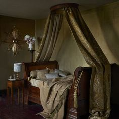 Imperiale - A stately and imposing collection of decorative fabrics. Opulent jacquard weaves and embroideries portrayed in indulgent shades of ebony, antique gold and ivory.