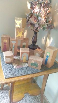 What a neat idea for a toddler's class! You could even use cardboard boxes or blocks to create a nativity scene--just add pics and cover with clear contact paper.