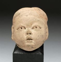 Pre-Columbian Olmec Baby Head Pre-Columbian, Mexico, Olmec culture, 12th - 9th c. BCE. One of t