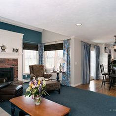 Dramatic Fireplace Makeover With Wainscoting To Cover The