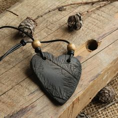 Check out this item in my Etsy shop https://www.etsy.com/ca/listing/266417796/clay-necklace-spruce-heart-smoke-fired