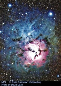 The Trifid Nebula.M20, in the constellation of Sagittarius. Star formation create not only the colors but the chaos. The red-glowing gas results from high-energy light striking hydrogen gas. The dark dust filaments that lace M20 were created in the atmospheres of cool giant stars and in the debris from supernovae explosions. Which bright young star lights up the blue reflection nebula is still being investigated. The light from M20 left 3000 years ago. Light takes about 50 years to cross…