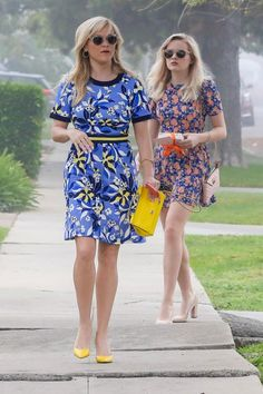 Reese Witherspoon wearing Saint Laurent Paris Leather Pump, Draper James Heart Change Purse, Draper James Bellamy Floral Persley Ponte Dress in Lavender Bellamy Floral and Dolce & Gabbana Sicily Small Bag