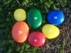 M and M painted Rocks! My girl would love this! A must do for the garden this summer!