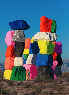 """Seven Magic Mountains"" is a colorful large-scale public artwork by Swiss artist Ugo Rondinone.  Located in the desert outside of Las Vegas, the installation features seven massive dayglow totems comprised of painted, locally-sourced boulders.  ""Visible across the desert landscape along Interstate 15,"
