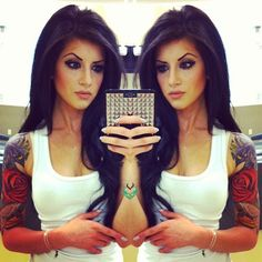 not diggin her eyebrows (although it works for her style) but i love her tattoos and hair and eye make up.