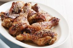 Honey Soy Chicken : 1/2 cup salt-reduced soy sauce 1/4 cup honey 2cm piece fresh ginger, peeled, finely grated 1 garlic clove, crushed 8 chicken drumsticks 2 teaspoons sesame seeds