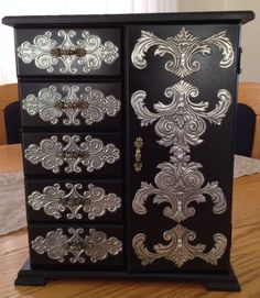 Pewter jewelry cabinet by Heather van den Bergh
