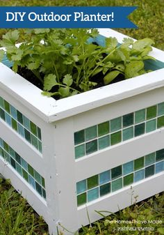 Spruce up a boring wood planter with colorful tiles and a fresh coat of paint! This is perfect for planting kitchen herbs or spring flowers in.
