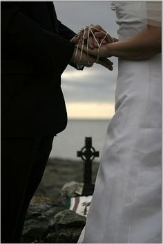 "Handfasting, an old Celtic ceremony of betrothal or wedding where the hands of the bride and groom are tied together with a cord. This is where he expression ""tying the knot"" comes from."
