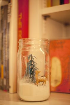 Super simple craft: Mason jar scenes. Fill a large Mason jar with powdered sugar (snow) and place cinnamon sticks, acorns, mini-pinecones, jingle bells and miniature figurines for a mantle or countertop decoration.