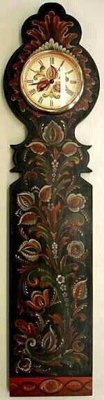 Clock. Yup, it's tole folk art painting. Beautiful!