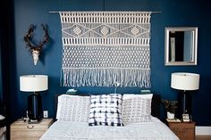 20 Of The Coolest Rooms In New York City #refinery29  http://www.refinery29.com/cool-rooms-nyc-apartment-pictures#slide-2  In place of a headboard, Kaplan's Brooklyn bedroom features a macramé wall hanging of her own design and a coat of deep, dark paint to encourage restful repose.