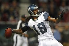 Sidney Rice passes the ball