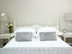 Farrow & Ball Skimming Stone, glass lamps, painted wooden bed and bedside tables/nightstands by Nicola Pratt interior design White Wall Bedroom, Home Bedroom, White Walls, Bedroom Decor, Master Bedroom, Bedrooms, Farrow Ball, Cabbage White Farrow And Ball, Farrow And Ball Bedroom