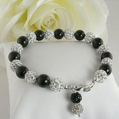 This bracelet is made with silver pave crystal balls and black Swarovski pearls.  Perfect for a bridesmaid.  BUY NOW http://jewelrybytali.com/products/black-pearl-crystal-ball-bracelet-crystal-pave-black-pearl-bridal-party-bracelet