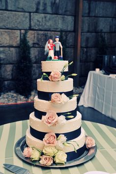 Wow, what an amazing wedding cake! Jeffrey Miller Catering. Maybe the same flowers I want but same idea we're looking for. love the navy ribbon!