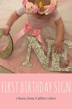 """This sign in glitter says """"ONE"""" and is perfect for your little one's first birthday, whether on display at the party or used for a photo shoot! Cut in wood and glittered in your choice color, this wooden letters decoration is sure to bring smiles to everyone's faces! #etsy #ad #firstbirthday #cakesmash #photo #glitter"""