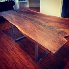 Modern Live edge single slab walnut table with steel base live edge natural edge modern steel base organic tree walnut industrial exotic metal slab designer contemporary