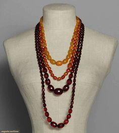 Four Amber Necklaces, 1910-1920, Augusta Auctions, MAY 13th & 14th, 2014, Lot 65
