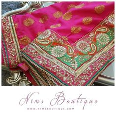 Maharani Pink Brocade Sari with Pearl Embellished Green & Orange Border, comes with gold unstitched blouse