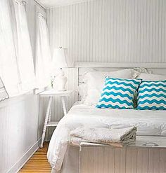 A white guestroom. An entirely new room by changing the pillows. Talk about cheap redecorating.